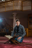 Religous person. Young religious person praying in a mosque Stock Images