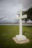 Religous symbol Cross by River. Cross by River for religious symbol of Christianity in park as a monument Royalty Free Stock Images
