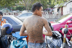 Religous tatoo. Yantra tattooing, also called sak yant (is a form of tattooing practiced in Southeast Asian countries including Cambodia, Laos, and Thailand. Sak stock images