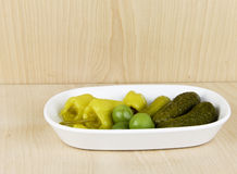 Relish dish of peppers, pickles and olives Stock Images