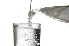 Relleno de un vidrio de agua Imagen de archivo libre de regalías