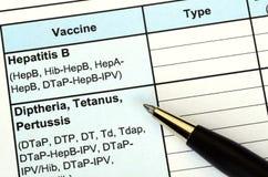 Relleno del expediente de la vacunación Imágenes de archivo libres de regalías