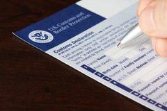 Relleno encima de aduanas de los E.E.U.U. y de formulario de la protección de la frontera Foto de archivo libre de regalías