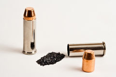 Reloading, .44 Magnum 2. Two .44 magnum rounds; one complete, one separated into it's components Royalty Free Stock Photo