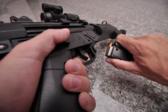 Reloading Submachine Gun. Replica MP5 A4 time out shot with my camera Royalty Free Stock Images