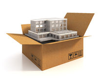 Relocation, Moving. Cargoboard box with building on the white Stock Photography