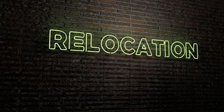 RELOCATION -Realistic Neon Sign on Brick Wall background - 3D rendered royalty free stock image. Can be used for online banner ads and direct mailers Royalty Free Stock Image