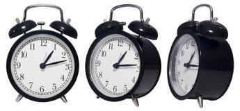 Reloj aislado del negro de la alarma del vintage Imagen de archivo