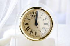 Reloj al mediodía Foto de archivo libre de regalías