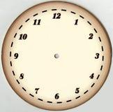 Reloj amarilleado, de papel del vintage del dial con 12 números y sin las flechas restablecido En un fondo blanco Foto de archivo libre de regalías