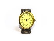 Reloj amarillo inusual con los números romanos Foto de archivo libre de regalías