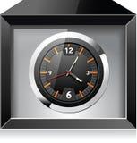 Reloj analogico retro en rectángulo negro Fotos de archivo