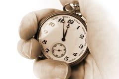 Reloj antiguo a disposición foto de archivo libre de regalías