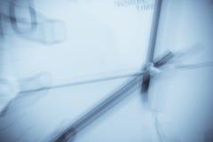 Reloj borroso en azul Imagenes de archivo