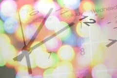 Reloj, calendario y luces. Foto de archivo libre de regalías