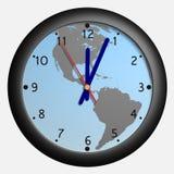 Reloj con el bkg del globo de la tierra Imagenes de archivo