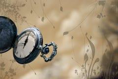 Reloj con el extracto Foto de archivo libre de regalías