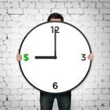 Reloj con el icono de los dólares fotografía de archivo libre de regalías