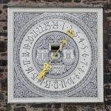 Reloj con las ilustraciones Foto de archivo