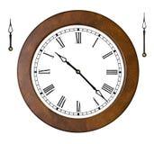 Reloj con las manos separadas imagen de archivo