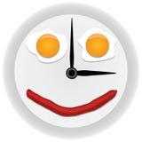 Reloj con los huevos revueltos Imagen de archivo libre de regalías