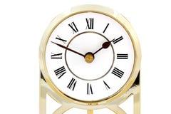 Reloj con los números romanos Fotos de archivo libres de regalías