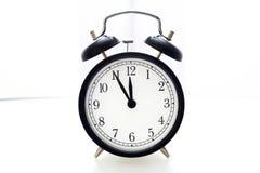 Reloj de alarma 5 a 12 Imágenes de archivo libres de regalías