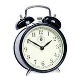 Reloj de alarma aislado Imagenes de archivo