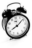 Reloj de alarma aislado en blanco Fotografía de archivo libre de regalías