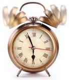 Reloj de alarma aislado en blanco. Imagen de archivo