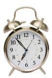 Reloj de alarma aislado en blanco Fotos de archivo