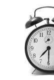 Reloj de alarma aislado sobre blanco Imagenes de archivo