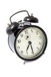 Reloj de alarma aislado sobre blanco Imagen de archivo