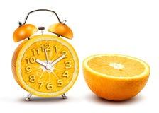 Reloj de alarma anaranjado imagen de archivo libre de regalías