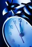 Reloj de alarma azul Imágenes de archivo libres de regalías