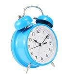 Reloj de alarma azul aislado Fotos de archivo libres de regalías