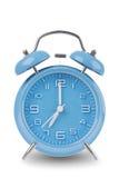 Reloj de alarma azul aislado en blanco Foto de archivo libre de regalías