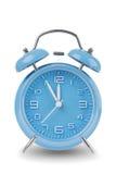 Reloj de alarma azul aislado en blanco Imagenes de archivo
