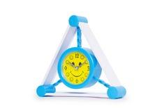 Reloj de alarma azul en blanco Imagen de archivo