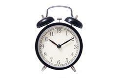 Reloj de alarma clásico negro del estilo Fotografía de archivo libre de regalías