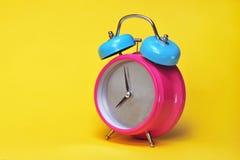 Reloj de alarma colorido Imagenes de archivo