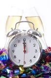 Reloj de alarma con el vidrio de Champán Fotografía de archivo libre de regalías