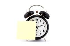 Reloj de alarma con la nota (1) Fotos de archivo libres de regalías