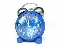 Reloj de alarma con la Reloj-Cara del invierno Imágenes de archivo libres de regalías