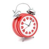 Reloj de alarma con los corazones Imagen de archivo