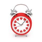Reloj de alarma con los corazones Fotos de archivo libres de regalías