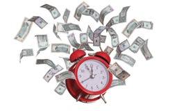 Reloj de alarma con los dólares que vuelan Foto de archivo libre de regalías