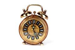 Reloj de alarma de cobre amarillo Fotografía de archivo