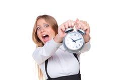 Reloj de alarma de la explotación agrícola de la mujer en pánico Imágenes de archivo libres de regalías