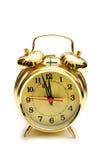 Reloj de alarma de oro aislado Imagen de archivo libre de regalías